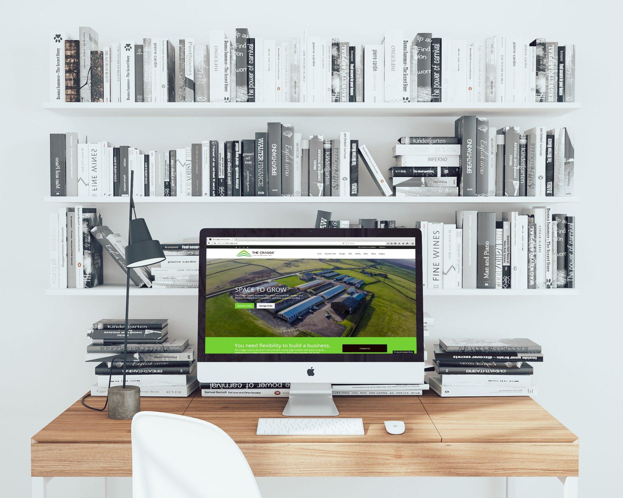 mockDrop iMac on a wooden desk - Website design for business park in Yorkshire